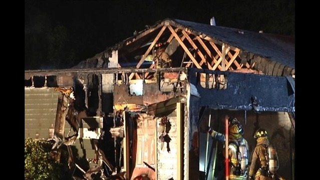 Fire Destroys Garage and Car but Occupant Saved
