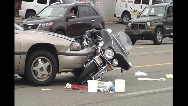 Car and Motorcycle Collide