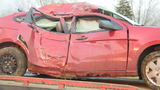 Woman in custody after police crash leads to crash