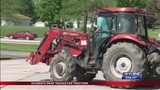 Northwestern High School students swap their vehicles for tractors